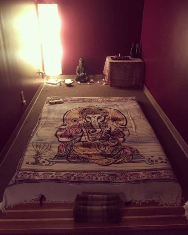 Photo of Erica Sparks Massage space set up for massage styles that use a Thai yoga mat